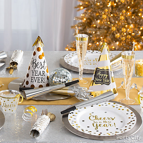 White and gold tablescape idea party city for New year eve party ideas